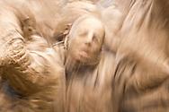Shiite muslim men in trance, covered in mud, self-flagellating during the Day of Ashura, in Bijar, Iran.