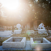 Unfortunaley some immigrants dont make it to their final destination.  Pictured are two graves with the title of Afghani on them stating their unknown status in one of the local cemetaries in Mytilene.  Image © Angelos Giotopoulos/Falcon Photo Agency..