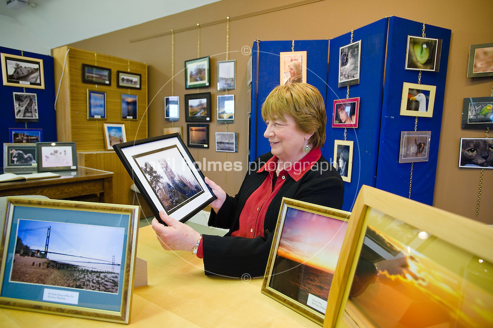Pauline Fulcher, secretory of Hedon Museum looks at photographs of local scenes in the Raw Talent Exhibition in the museum's gallery...Established in 1996, Hedon Museum is a small independent museum staffed entirely by volunteers...The Museum collects, preserves and displays documents and artefacts relating to the civic, trades, social and domestic life of Hedon and the surrounding area of South Holderness...The Hedon Room displays aspects of the history of the town and the Small Room contains themed exhibitions which change twice per year. The Upstairs Gallery, however, has frequently changing displays including photographs, paintings, crafts and local artefacts...There is a small reference library of local and general interest...For those interested in researching family history there are census returns on cdrom and internet access is available...The museum hosts its own shop and tea & coffee are served in the Upstairs Gallery.