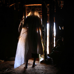 Leyualem Mucha, 14, walks by her mother Enat Ante, as she prepares for her groom in the Amhara Region, Ethiopia on May 23, 2007. Leyualem had never met her husband before her wedding day, yet sumitted as they bound her in the white wedding cloth. The men later said it was placed over her head so she would not be able to find her way back home, should she want to escape the marriage.