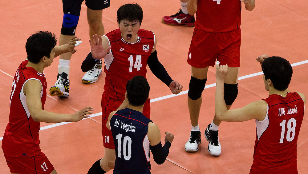 Hui-Chae Song (14) celebrates a winning point versus Canada during a World League Volleyball match at the Sasktel Centre in Saskatoon, Saskatchewan Canada on June 24, 2016.