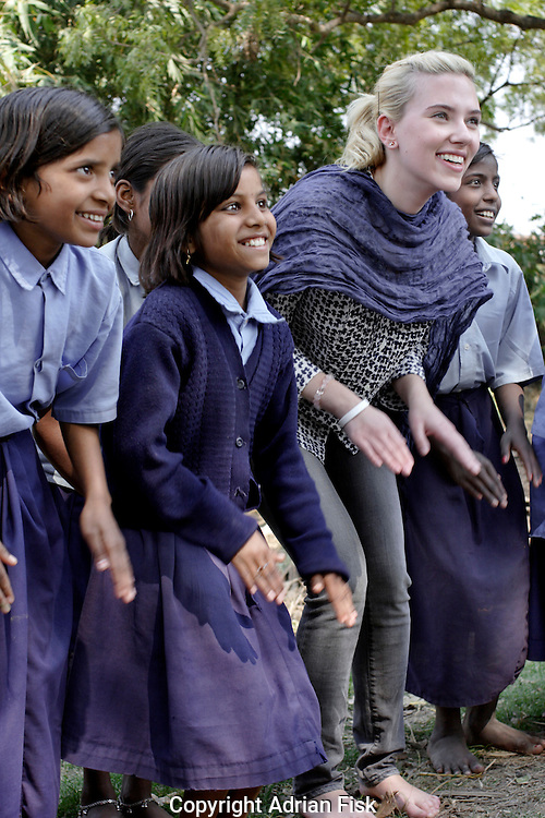 Scarlett Johansson laughs with school girls at an Oxfam funded rural Dalit school in Ghazipur district in the north Indian state of Uttar Pradesh. The school which was started in 2001 was set up to enable poor low caste Dalit children to gain an education in an area of India where the literacy rate stands at 19%.