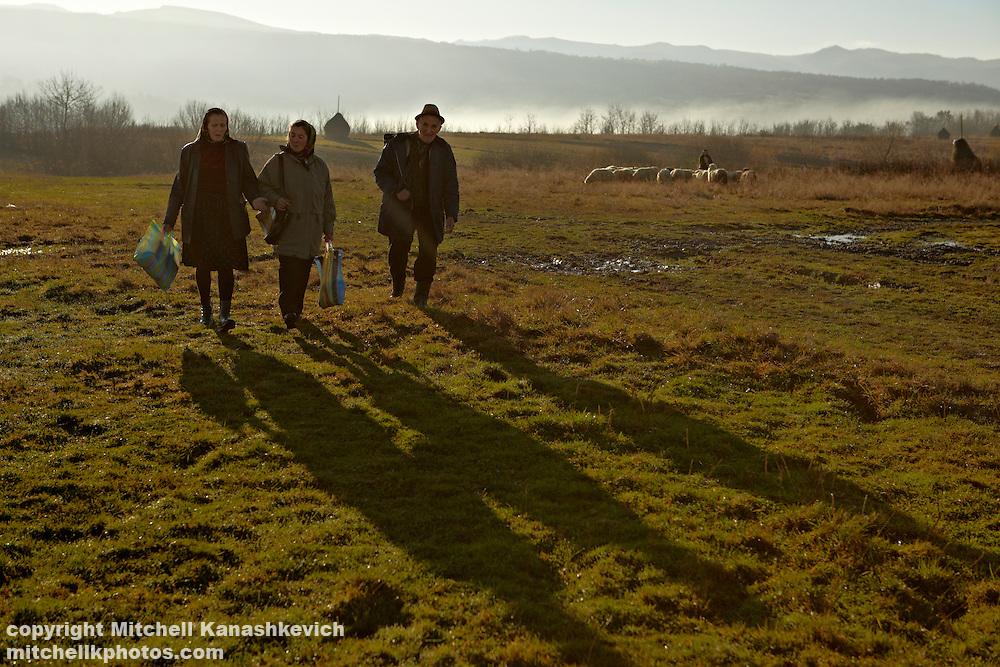 Romanian elders walking to a market. Maramures