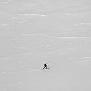 A back country ski tourer traverses the Rainbow Glacier, near Whistler, BC, Canada