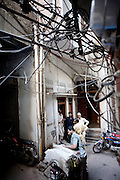 Workers wait for power to be restored at a workshop in the 'Old City' sector of Lahore. ..Parts of Pakistan are reportedly suffering 12-20-hours of electricity load shedding (power outages) per day. Many industries are suffering as a result of not being ale to use production machinery during load shedding and are unable meet deadlines for manufacture and delivery of goods.