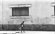 Old man walking in the Dili streets @ Martine Perret. 17 May 2002