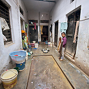 In this communal courtyard, several families use the same place to wash dishes, clothes and do ther household work.