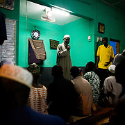A local imam speaks to mosque attendees about an upcoming national polio immunization exercise after evening prayers at a mosque in Tamale, Ghana on Tuesday March 24, 2009.