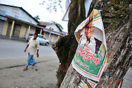A man walks under a Congress party campaign banner near a polling station during the second phase of voting in parliamentary elections April 23, 2009 in the town of Mukalmua in the state of Assam, India.  Congress party leaders Rahul Gandhi and Kamal Nath, the commerce minister, and key government allies face Indian voters today in the second round of polling in a five-stage general election.
