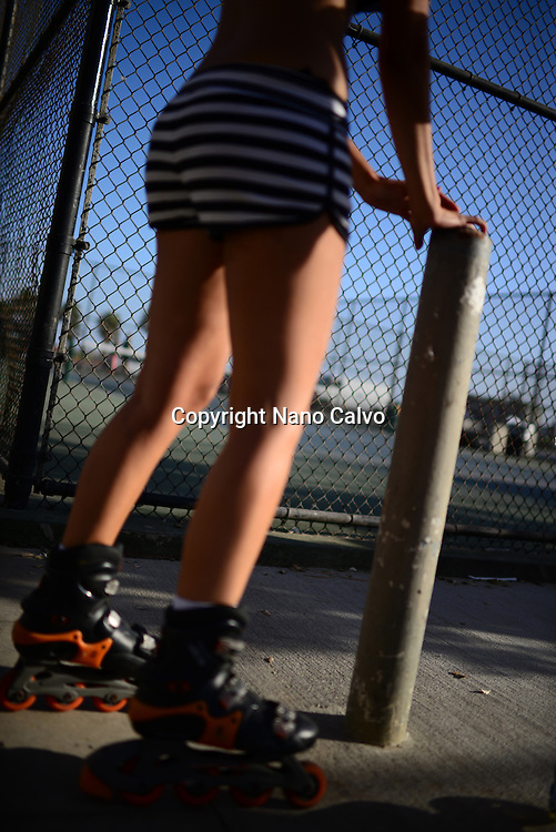 Young girls roller skating in Venice Beach, California.