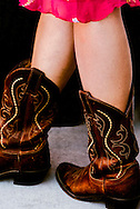Cowgirl, cowboy boots, red dress