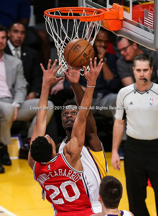 Los Angeles Lakers forward Julius Randle (#30) blocks a shot by Philadelphia 76ers guard Timothe Luwawu-Cabarrot (#20) during an NBA basketball game Tuesday, March 12, 2017, in Los Angeles. <br /> (Photo by Ringo Chiu/PHOTOFORMULA.com)<br /> <br /> Usage Notes: This content is intended for editorial use only. For other uses, additional clearances may be required.