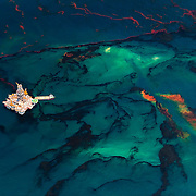 Oil spilled from the BP Deepwater Horizon wellhead rises up to the surface of the Gulf of Mexico near the Development Driller II platform, May, 2010.