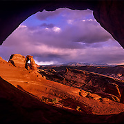 Utah, Southwest<br /> Famous Delicate Arch seen at sunset through Frame Arch, Arches Narional Park, Utah.