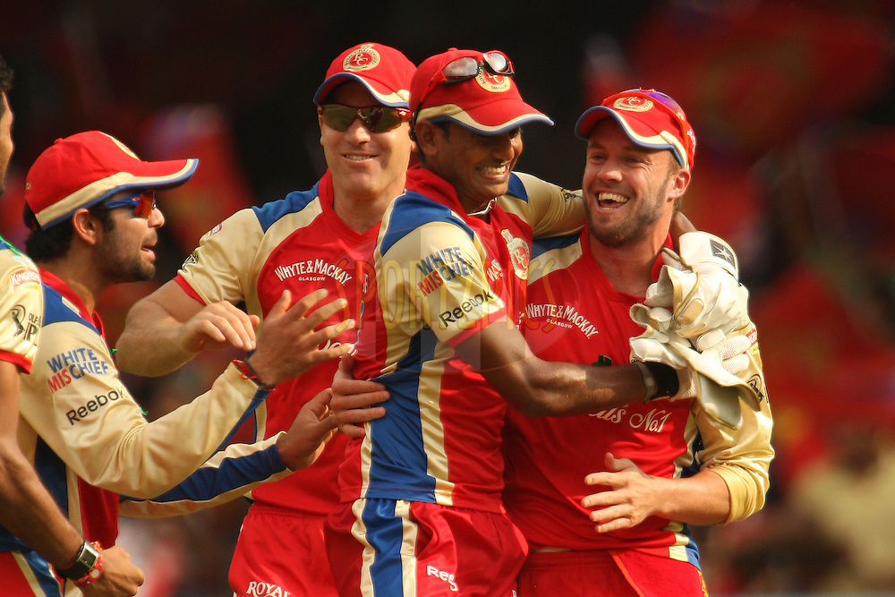 RCB players congratulate AB de Villiers on taking a catch during match 58 of the the Indian Premier League ( IPL ) Season 4 between the Royal Challengers Bangalore and the Kolkata Knight Riders held at the Chinnaswamy Stadium, Bangalore, Karnataka, India on the 14th May 2011..Photo by Jacques Rossouw/BCCI/SPORTZPICS.