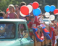 Kids ride in a truck in the 4th of July parade in Oxford, Miss. on Monday, July 4, 2011.