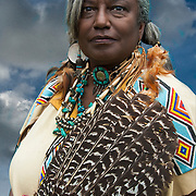 Pow Wow Portrait of Eve Wind Dancer Young,  Native and African American of mixed heritage ( Cherokee / Lumbee / Black Creek ) at Thunderbird Pow-Wow in Queens County Farm, New York.<br />