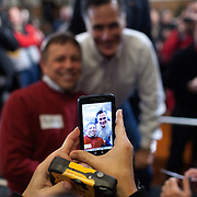 Former Gov. Mitt Romney (R-MA) poses with supporters after a rally at the Mississippi Valley Fairgrounds Monday, January 2, 2012, in Davenport, IA...Photo by Khue Bui