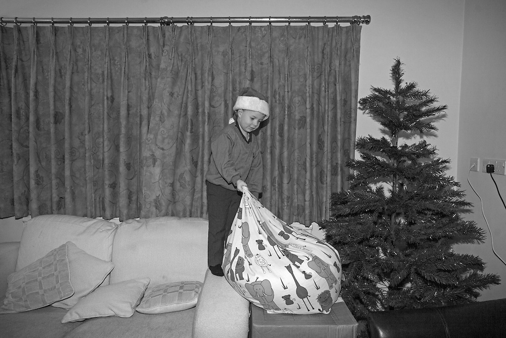 James plays next his family's Christmas tree  at his home in Berkhamsted, England Monday, Dec. 7, 2015 (Elizabeth Dalziel) #thesecretlifeofmothers #bringinguptheboys #dailylife