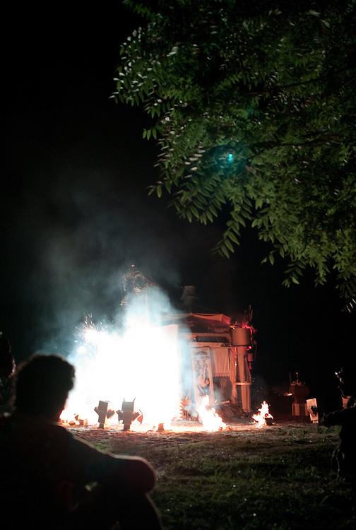 Fireworks go off as the Effigy burns.  Lee Mayjahs looks on.