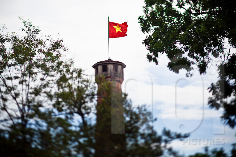 The Vietnamese flag blows in the wind atop the Cot Co watchtower, Hanoi, Vietnam, Southeast Asia