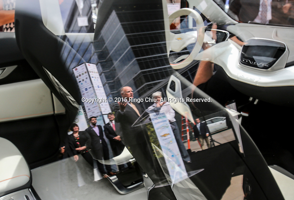 California Gov. Jerry Brown is reflected at the window of  the Chevrolet Bolt EV concept car as he speaks in Drive the Dream 2015 event at Creative Artists Agency in Los Angeles October 15, 2015.  (Photo by Ringo Chiu/PHOTOFORMULA.com)