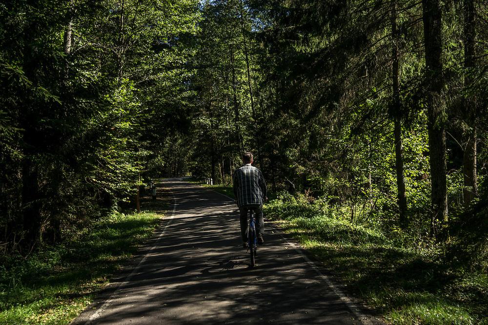 A bicycle path on Sunday, September 18, 2016 in Belozhevskaya Pushcha National Park near Kamieniuki, Belarus.