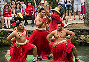 """Dancers of Tonga in the Canoe Pageant, """"Rainbows of Paradise."""" The Polynesian Cultural Center (PCC) is a major theme park and living museum, in Laie on the northeast coast (Windward Side) of the island of Oahu, Hawaii, USA. The PCC first opened in 1963 as a way for students at the adjacent Church College of Hawaii (now Brigham Young University Hawaii) to earn money for their education and as a means to preserve and portray the cultures of the people of Polynesia. Performers demonstrate Polynesian arts and crafts within simulated tropical villages, covering Hawaii, Aotearoa (New Zealand), Fiji, Samoa, Tahiti, Tonga and the Marquesas Islands. The Rapa Nui (Easter Island) exhibit features seven hand-carved moai (stone statues). The PCC is run by the Church of Jesus Christ of Latter-day Saints (LDS Church). For this photo's licensing options, please inquire."""