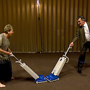 Judy Peterson and Dan Black clean up after the alternative Mormon prom at the Church of Jesus Christ of Latter-day Saints in Naperville, Ill.