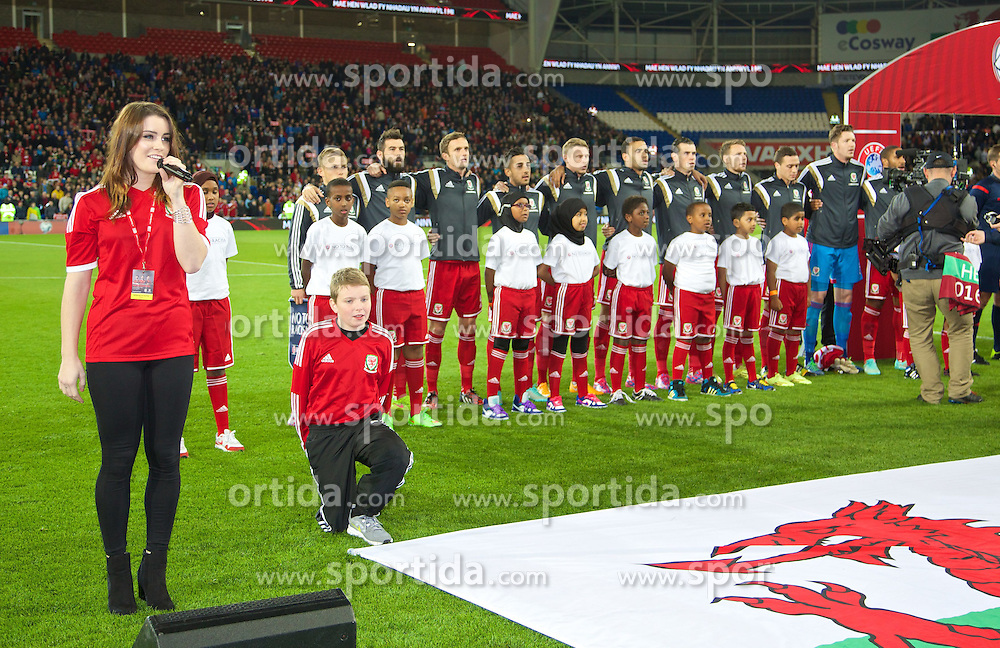 13.10.2014, City Stadium, Cardiff, WAL, UEFA Euro Qualifikation, Wales vs Zypern, Gruppe B, im Bild Lucie Jones sings the national anthem before Wales take on Cyprus // 15054000 during the UEFA EURO 2016 Qualifier group B match between Wales and Cyprus at the City Stadium in Cardiff, Wales on 2014/10/13. EXPA Pictures &copy; 2014, PhotoCredit: EXPA/ Propagandaphoto/ David Rawcliffe<br /> <br /> *****ATTENTION - OUT of ENG, GBR*****