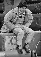 Despite qualifying second for the 1979 US Grand Prix, Paramalat-Brabham Formula One driver Nelson Piquet's face shows the strain of a very difficult Formula One season. Brazilian Piquet had partnered three-time World Champion Niki Lauda to race the Brabham-Alfa Romeo BT48. The engine proved to be unreliable, with Piquet retiring from eight of the first eleven grands prix. <br /> <br /> With Alfa Romeo building its own Formula One team and car, Brabham team owner Bernie Ecclestone ended the Alfa engine contract and Brabham Designer Gordon Murray set about using sections of the BT48 monocoque with the Cosworth DFV engine to produce a new car, the BT49 in six weeks. The cars arrived just in time for the Canadian Grand Prix, the penultimate race of the 1979 season. There Niki Lauda shocked the team by suddenly quiting the sport after 10 laps of the first practice session, leaving young Nelson Piquet as the team leader. <br /> <br /> Nevertheless, Piquet stepped forward to meet the challenge and ran third in the race on the high speed Circuit &Icirc;le Notre-Dame before retiring with a broken gearbox. At the US Grand Prix, he would start on the front row, set fastest lap, but retire a few laps from the end with a broken drive shaft. He would go on the win three World Driver's Championships during a tempestuous 13-year career with Brabham, Williams, Lotus, and Benetton.