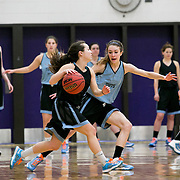 03/19/2014- Stevens Point, Wisc. - Tufts guard Kelsey Morehead, A15, drives past Tufts guard Josie Lee, A17, during their first practice at Berg Gym before the NCAA Division III Women's Final Four on Mar. 19, 2014. (Kelvin Ma/Tufts University)