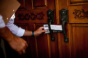 Democratic congressional challenger Eric Swalwell leaves a note while campaigning door-to-door in Pleasanton, Calif., September 21, 2012.