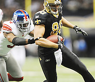 New Orleans Saints' Jimmy Graham (80) scores a touchdown vs. New York Giants' Deon Grant (34) at the Superdome in New Orleans, La. on Monday, November 28, 2011. New Orleans won 49-24.