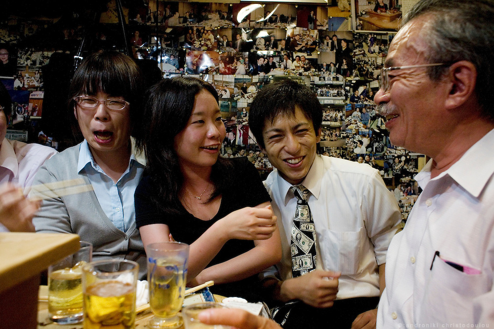 People having fun in Aizu restaurant at Nonbei street. Nonbei street in Shibuya is a narrow street with little restaurants and bars, each one with a special character. Tokyo 16 September 2008, Japan