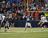 Ole Miss quarterback Bo Wallace (14) vs. Texas A&M defensive lineman Spencer Nealy (99) in Oxford, Miss. on Saturday, October 6, 2012. Texas A&M won 30-27...