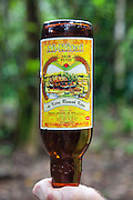 Arak Putih 52% white rice wine served in recycled tiger beer bottle