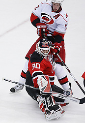 Apr 23, 2009; Newark, NJ, USA; New Jersey Devils goalie Martin Brodeur (30) makes a save on Carolina Hurricanes center Eric Staal (12) during the second period of game five of the eastern conference quarterfinals of the 2009 Stanley Cup playoffs at the Prudential Center.