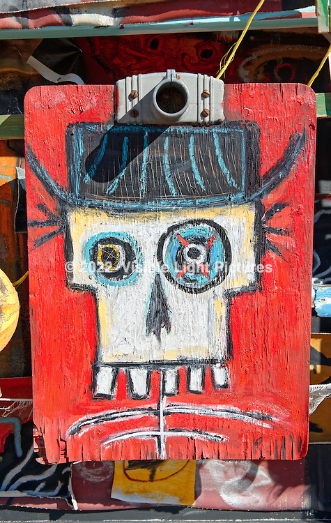 Skeleton head with a black hat.