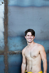 shirtless man smiling
