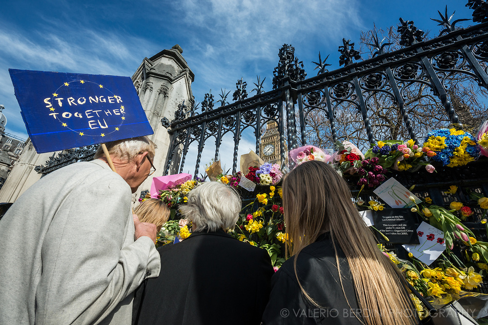 People attending the March for Europe stop by the House of Parliament to leave flowers in the memory of the policeman stabbed by a terrorist.