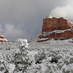 A spring storm in Sedona blankets the forest floor, gives the red rocks some beautiful contrast and tops it off with some lifting clouds.