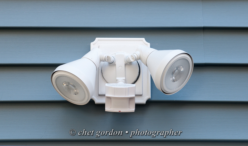 Electrical sensor light fixture mounted on the side of Craig Furer's Cranford, NJ home on Sunday, October 23, 2016. Furer and his wife Jen hired Magnolia Home Remodeling Group to complete a full exterior makeover. The company replaced the siding with shake and clapboard, added various architectural accents, replaced the roof, modified the roofline, built a front portico and replaced two windows. Craig spent a lot of time researching this project before it began and is thrilled with the overall result.  © Chet Gordon for Angie's List