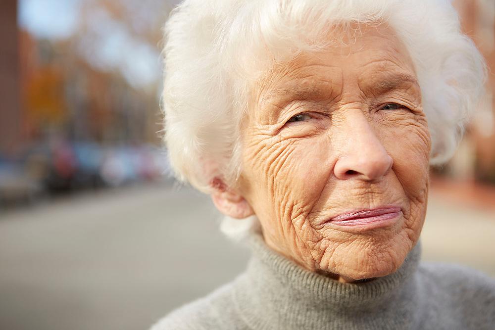 Portrait photograph of happy old granny