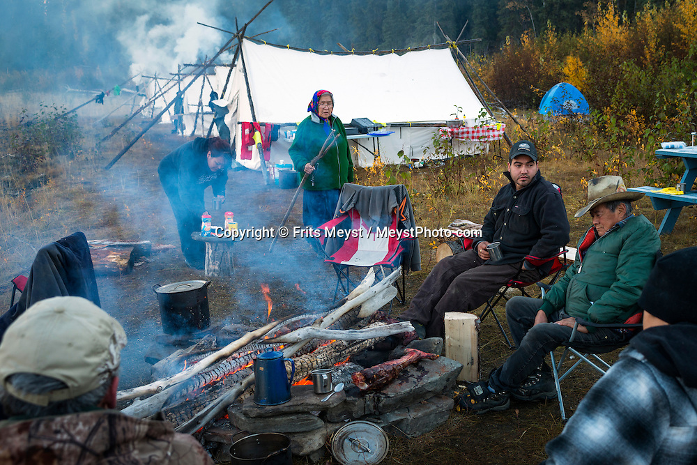Mayo, Yukon Territory, Canada, September 2014. Band members of the First Nation of NaCho Nyak Dun return to their traditional fishing spot below the Fraser Falls on the Stewart River to fish for Whitefish and Chum . The nation has agreed to not fish salmon for the duration of a full life cycle of the declining species. So few salmon have reached their traditional spawning grounds that they are threatened by extiction.  Photo by Frits Meyst / MeystPhoto.com