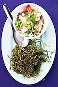 Yam Talay, seafood salad to be mixed with seaweed at Mor Mu Dong Restaurant, Phuket.