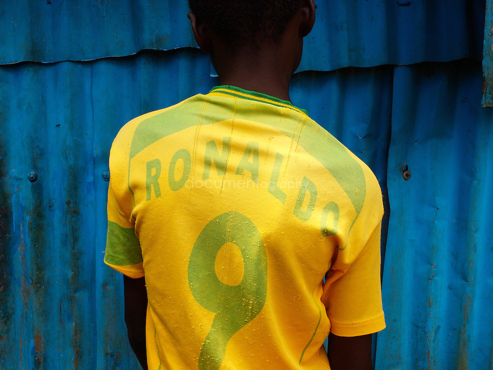 A child with a Ronaldo t-shirt, Kroo Bay, Freetown, Sierra Leone.
