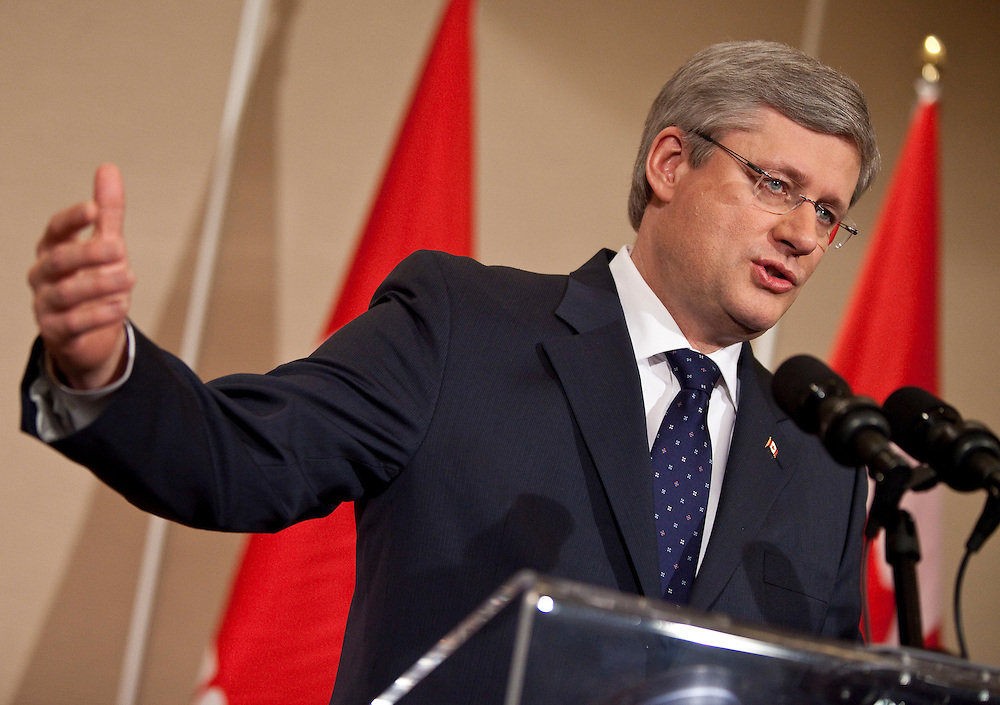 Prime Minister Stephen Harper speaks to the media at a press conference in Calgary, Alberta, May 3, 2011 following the election of a Conservative majority government in the federal election yesterday.<br /> AFP/GEOFF ROBINS/STR