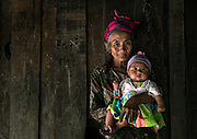 A Hmong grandmother and child in a mountain village near Luang Prabang, Laos.