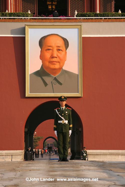 Mao Portrait at the Palace Museum, Forbidden City - Since 1925 the Forbidden City has been under the charge of the Palace Museum, whose extensive collection of artwork and artifacts were built upon the imperial collections of the Ming and Qing dynasties.  Inside the gates, and away from the Chinese guards and Mao's portrait is where these treasures are to be found.